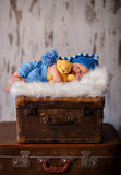 Newborn photography of 2 weeks old sleeping baby on soft fluffy Royalty Free Stock Photos