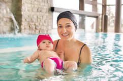 Newborn pool mom baby Stock Photography