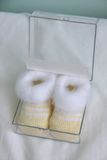 Newborn shoes baby bootees Royalty Free Stock Images