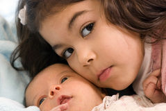 Newborn and sister Royalty Free Stock Images