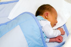 Newborn sleeping. One week baby sleeping. Face is a little yellow because of neonatal jaundice Stock Photo