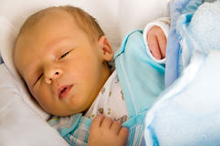 Newborn sleeping. One week baby sleeping. Face is a little yellow because of neonatal jaundice stock photography