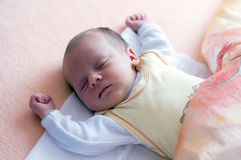 Newborn sleeping. Two week baby sleeping with hands up Royalty Free Stock Photo