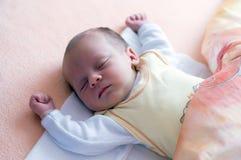 Newborn sleeping. Two week baby sleeping with hands up royalty free stock photo