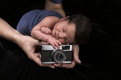 Newborn sleeping baby with old camera.  Royalty Free Stock Images