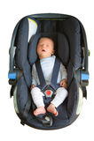 Newborn sleeping in car seat Royalty Free Stock Images