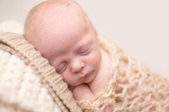 Newborn Sleeping on Chair Stock Photos