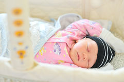 Newborn sleeping in the crib Stock Images