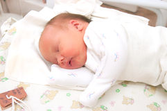 The newborn sleeps. Image asleep new-born wrapped in a diaper Stock Photo