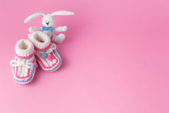 Newborn small toy with booties Royalty Free Stock Photo