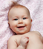 Newborn smiling baby Stock Photo