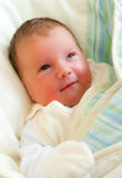 Newborn smiling baby girl Stock Image