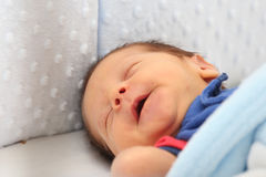 Newborn smiling in his dream Royalty Free Stock Photography