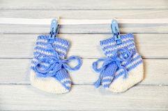 Newborn socks hanging on the wire Royalty Free Stock Images