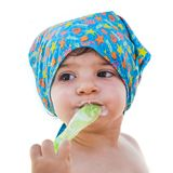Newborn spoon eat itself isolated bandana baby face summer sea outfit Royalty Free Stock Images
