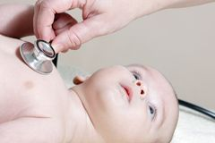 Newborn with stethoscope Royalty Free Stock Photos