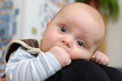 Newborn sucking fingers Stock Photos