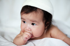 Newborn Sweet Baby with Fingers in Mouth Royalty Free Stock Photography