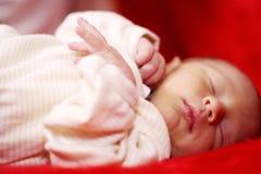 Newborn sweet dreams. Newborn baby sleeping having a nice sweet dream Royalty Free Stock Photos