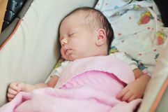 Newborn in pram Royalty Free Stock Images