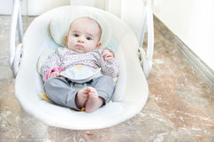 Newborn swing baby swing automatic electrical chair.  royalty free stock images
