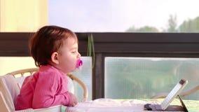 Newborn tablet tv digital native.  stock footage