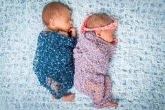 Newborn twins l sleeping on a blanket Royalty Free Stock Photos