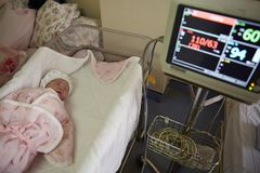 A newborn under monitoring by machine Royalty Free Stock Photography