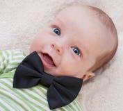 Newborns happy gentleman. Happy newborn baby gentleman in the butterfly stock image
