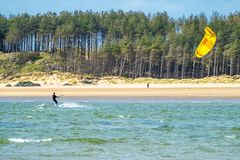 Newborough , Wales - April 26 2018: Martin Lamb is enjoying the beach with his kite Stock Images