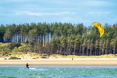 Newborough , Wales - April 26 2018: Martin Lamb is enjoying the beach with his kite Stock Photo