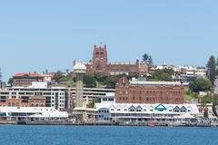 Newcastle Foreshore, Newcastle, New South Wales, Australia. Newcastle Foreshore with Queens Wharf Brewery in the foreground and Christ Church Cathedrral in the Royalty Free Stock Photos