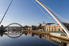 Newcastle Gateshead Quayside with Millenium and Tyne Bridges in. Newcastle Gateshead Quayside with River Tyne, Gateshead Millenium Bridge and Tyne Bridge in view Royalty Free Stock Images