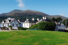Newcastle, Mourne Mountains, Northern Ireland. A view of houses and the mountains Royalty Free Stock Photo