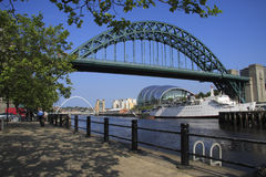 Newcastle Quayside. The Tyne and Millennium bridges, with the curved and shiny roof of the Sage Centre to the right. Taken from Newcastle's quayside Royalty Free Stock Photography