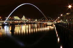 Newcastle quayside at night. Newcastle bridges, shot from the quayside at newcastle reflected in the still Tyne royalty free stock photography