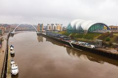 Newcastle Quayside with Sage, Gateshead Millenium Bridge and Boa. Ts in view on a cloudy day Stock Photo