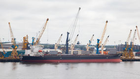 NEWCASTLE UPON TYNE, ENGLAND - JULY 23, 2014: Ship being loaded. Stock Photos