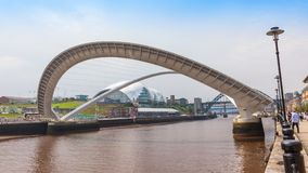 Gateshead Millennium Bridge. NEWCASTLE UPON TYNE, ENGLAND - JULY 5, 2012: A view of Gateshead Millennium Bridge, which crosses the  River Tyne, in Newcastle Upon Stock Image