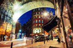 Under the Tyne bridge at night. Illuminated landmarks in Newcastle, UK. Newcastle upon Tyne, UK. Under the Tyne bridge at night. Illuminated landmarks in stock photo