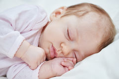 Neweborm baby girl sleeping Royalty Free Stock Image