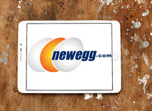 Newegg logo. Logo of newegg online retailer of items including computer hardware and consumer electronics on samsung tablet on wooden background Royalty Free Stock Images