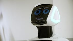 Newest Robotic Technology. the robot smiles and looks at the camera. friendly humanoid robot shows interest in the world. Newest Robotic Technology. robot smiles stock video