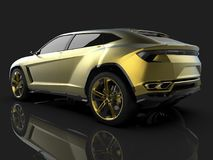 The newest sports all-wheel drive gold premium crossover in a black studio with a reflective floor. 3d rendering. The newest sports all-wheel drive gold premium Royalty Free Stock Photo