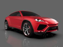 The newest sports all-wheel drive red premium crossover in a gray studio with a reflective floor. 3d rendering. The newest sports all-wheel drive red premium Stock Photo