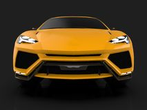 The newest sports all-wheel drive yellow premium crossover in a black studio with a reflective floor. 3d rendering. The newest sports all-wheel drive yellow Royalty Free Stock Photo
