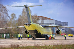 Newest transport aircraft Antonov An-178 is towed to flight test airfield, April 16, 2015 Royalty Free Stock Image