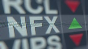 NEWFIELD EXPLORATION NFX stock ticker on the screen. Editorial loopable animation. Stock ticker on the screen. Editorial animation stock footage