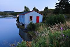 Newfoundland fishing shack. Scenic view of traditional fishing shack by sea at dusk, Newfoundland and Labrador, Canada Royalty Free Stock Photo