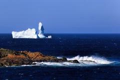 Newfoundland iceberg in spring time. Iceberg drifting along the Newfoundland coastline in spring royalty free stock photo